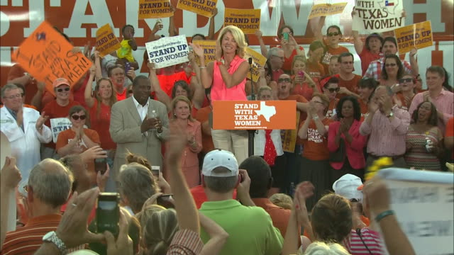 ft. worth pro abortion rally fans cheer wendy davis at ft. worth pro abortion rally - human rights or social issues or immigration or employment and labor or protest or riot or lgbtqi rights or women's rights stock videos & royalty-free footage