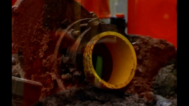 fuel bills expected to rise sharply ext / day engineer working on gas main replacement on street - replacement stock videos and b-roll footage