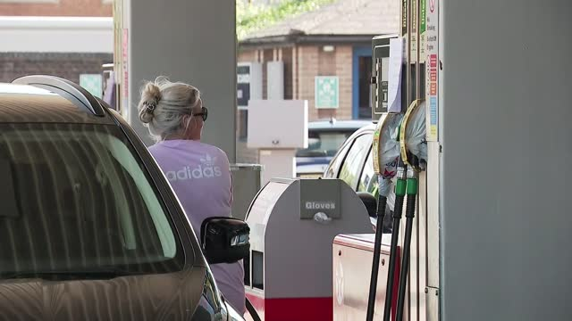 army drivers to be deployed; england: gloucestershire: gloucester: ext 'sorry out of use' sign on petrol pump pull focus petrol station worker... - rack focus stock videos & royalty-free footage