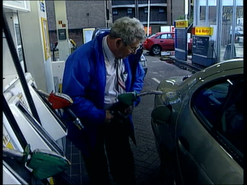 fuel crisis petrol station queues start england unspecified location ls man at petrol pump filling car gv sign in front of pumps no unleaded man... - petrol tank stock videos and b-roll footage
