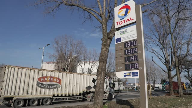 vídeos de stock e filmes b-roll de fuel prices are displayed on a sign during the inauguration on a total site of the largest natural gas station for vehicles and biongv in france on... - gas station