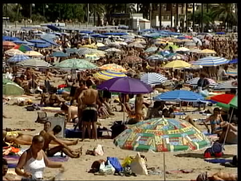 Fuel prices rise LIB GVs People sunbathing on sunny beach Holidaymakers along on jet skis