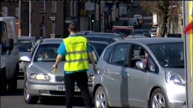 fuel tanker drivers' threatened strike: queues at petrol stations; england: dorset: police officer in discussion with petrol station staff on... - イングランド南西部点の映像素材/bロール