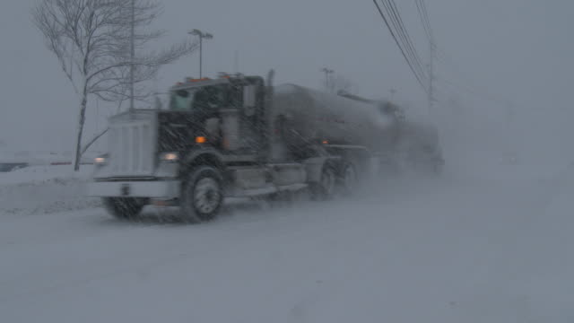 a fuel tanker navigates snow covered roads and near zero visibility near adams new york during a heavy lake effect snowstorm - scott mcpartland stock videos & royalty-free footage