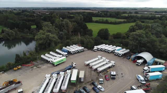 fuel tankers, reported in local media to be from the u.k. government's emergency fleet, aerial view, at a depot in fenstanton, u.k., on thursday,... - horizon over land stock videos & royalty-free footage