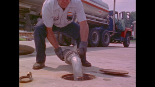 fuel truck drivers supply filling stations after oil embargo - fuel crisis stock videos and b-roll footage