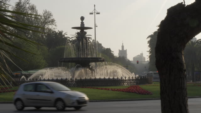 fuente de las tres gracias fountain roundabout, malaga, andalucia, spain, europe - moped stock videos and b-roll footage