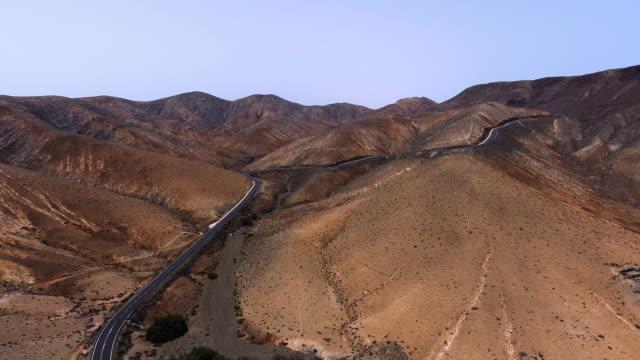 fuerteventura mountains road aerial view - tarmac stock videos & royalty-free footage