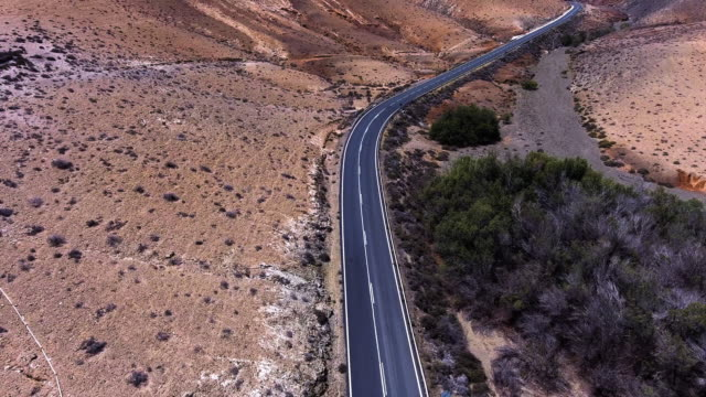 fuerteventura mountains road aerial view - empty road stock videos and b-roll footage