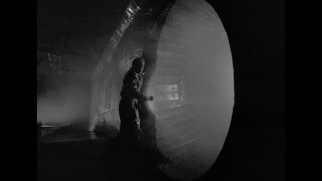 1948 a fugitive evades police in underground storm drains - film noir style stock videos and b-roll footage