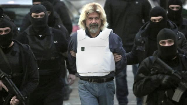 a fugitive ex member of a notorious greek radical leftist group was planning an armed attack on greeces main prison when he was captured this weekend... - sonntag stock-videos und b-roll-filmmaterial