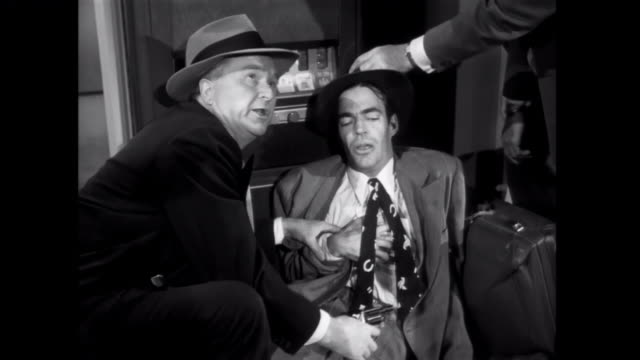 1952 a fugitive gangster is shot by police at airport gift shop - murder stock videos & royalty-free footage