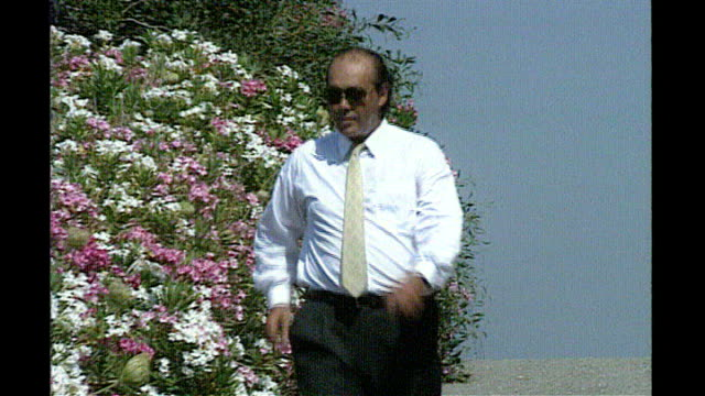 fugitve tycoon asil nadir wins legal battle to return to britain lib asil nadir along past shrub bushes flowers - eurasia stock videos and b-roll footage
