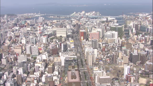 fukuoka stretches to the edge of the ocean. - fukuoka prefecture stock videos and b-roll footage