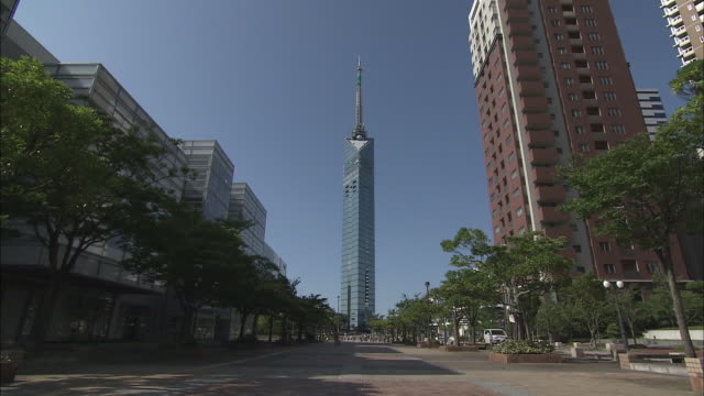 fukuoka tower is one of the most popular landmark tower in fukuoka also plays an important role as the transmission tower which is located at the... - microwave tower stock videos & royalty-free footage