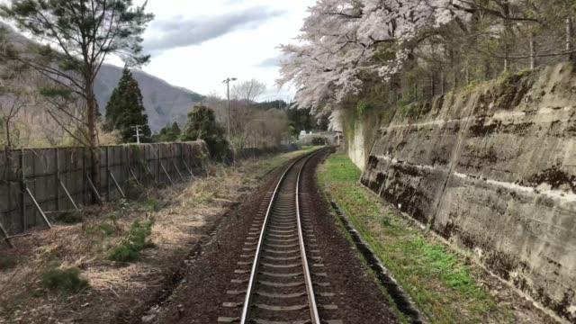 fukushima sakura season (4k) - railway station stock videos & royalty-free footage