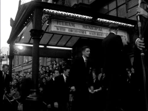 fulham fc attend civic reception england london fulham town hall ext tommy trinder shakes hands with the leonard fenton / fulham players up to dais /... - town hall stock videos and b-roll footage