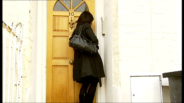 reporter sepaking into intercom at entrance to nigel duncan's home - intercom stock videos and b-roll footage