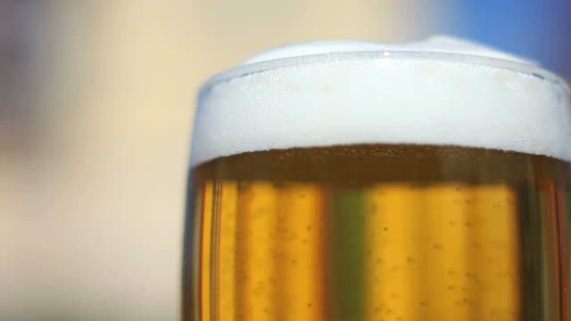 full beer glass close-up - pint glass stock videos & royalty-free footage