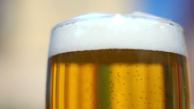 full beer glass close-up - frische stock videos & royalty-free footage