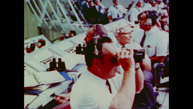 full bleachers and control room on the day apollo 11 launches - sala di controllo video stock e b–roll