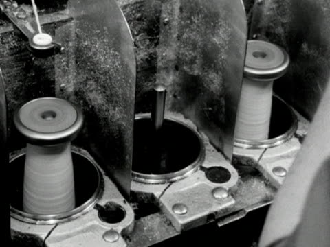 full bobbins of wool are removed from a machine and replaced with empty ones at a wool mill - ball of wool stock videos & royalty-free footage