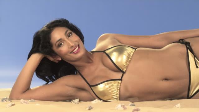 full body of woman wearing a bikini - braunes haar stock-videos und b-roll-filmmaterial