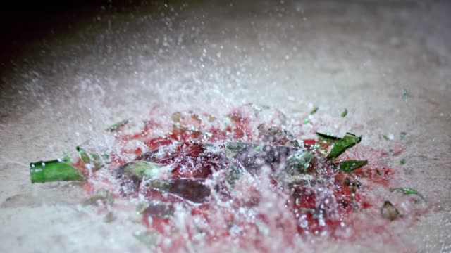 slo mo a full bottle of red wine breaking as it hits the floor - wine bottle stock videos & royalty-free footage