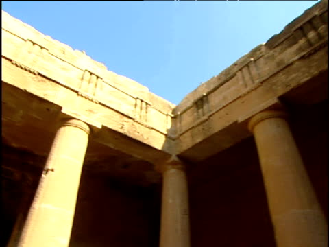 full circle pan around the pillars inside the court yard of the tomb of the kings in bafos cyprus. - doric stock videos & royalty-free footage