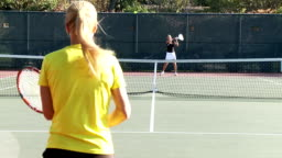 Full court tennis game in slow motion