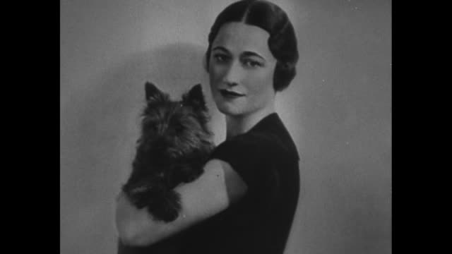 full face portrait of wallis simpson / she holds a scottish terrier / portrait of her in oval frame / right 3/4 photo / repeat of first shot / very... - straw hat stock videos and b-roll footage