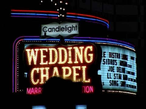 full frame neon sign 'wedding chapel', las vegas - chapel stock videos & royalty-free footage