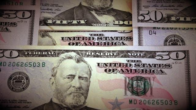 Full frame of 50 dollars bills moving in slow motion