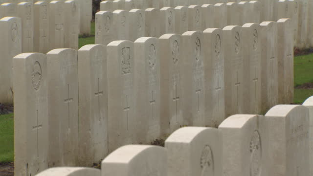 Full frame pan across rows of headstones for soldiers of the First World War Tyne Cot Cemetery Belgium FKAZ191X Clip taken from programme rushes...