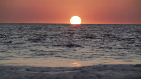 full hd full time footage and sound real time omega sunset over the sea - audio available stock videos & royalty-free footage