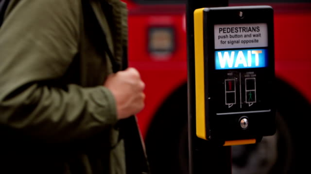 full hd slow motion color footage of a typical wait sign for pedestrians in london, uk. - non us film location stock videos & royalty-free footage