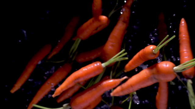 full hd slow motion fresh carrot - carrot stock videos & royalty-free footage
