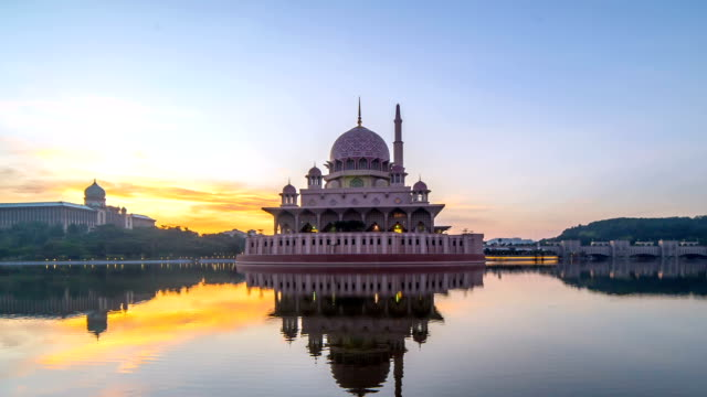 full hd time lapse of beautiful sunrise at putrajaya mosque. tilt up - putrajaya stock videos & royalty-free footage