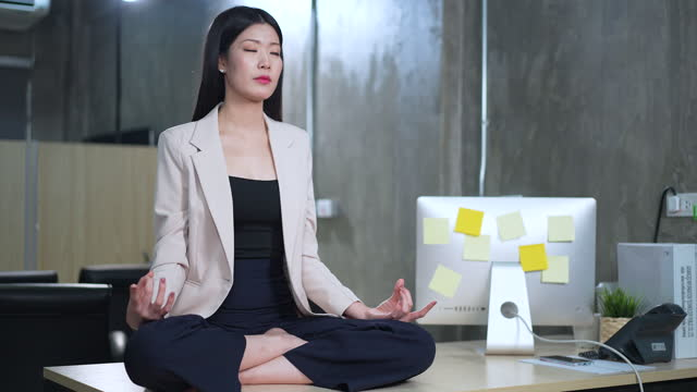 full length body meditation female at office - 2005 stock videos & royalty-free footage