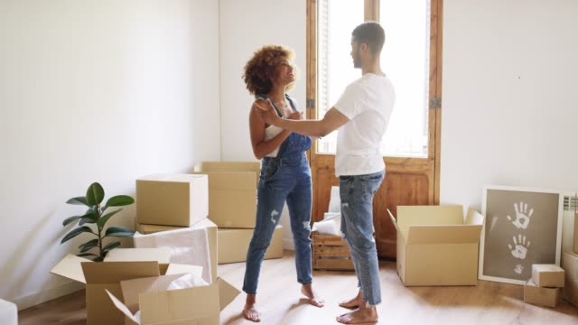 full length of young couple embracing at new home - moving house stock videos & royalty-free footage
