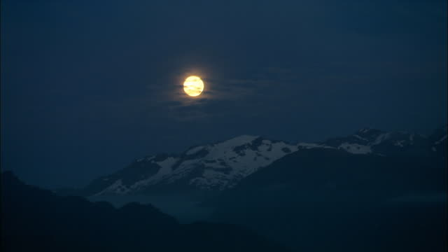 ws, pan, full moon above mountains, night, fiordland national park, new zealand - real time stock videos & royalty-free footage