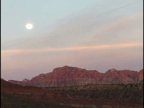 ms, full moon above red rocks, zion national park, utah, usa - placca di montaggio fissa video stock e b–roll