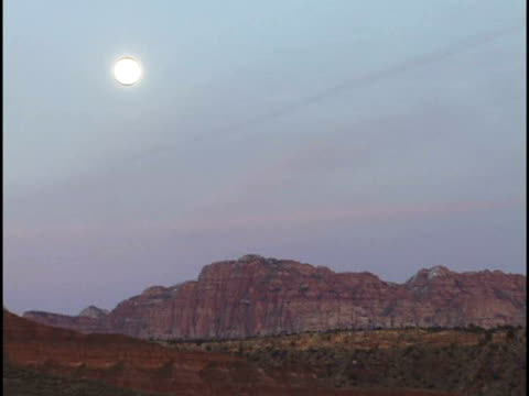 ms, full moon above red rocks, zion national park, utah, usa - stationary process plate stock videos & royalty-free footage