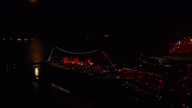 aerial zi full moon and queen mary moored in long beach harbor at night, california, usa - long beach california stock videos & royalty-free footage