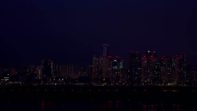 full moon and sunrise scenery of songdo ibd, taken from baegot life park in the western sea / siheung-si, gyeonggi-do, south korea - sea life park stock videos & royalty-free footage