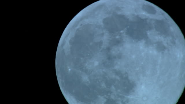 vídeos y material grabado en eventos de stock de a full moon brightens the night sky. - cráter