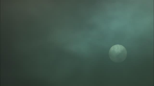 ws, full moon covered with dark wispy clouds, torres del paine national park, chile - tonad bild bildbanksvideor och videomaterial från bakom kulisserna