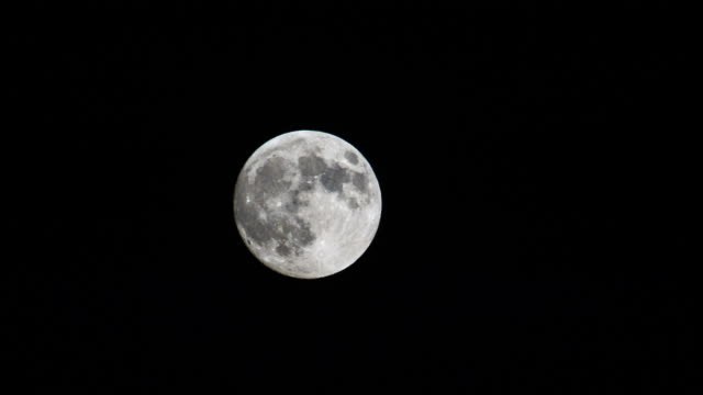 full moon in night sky.tokyo, japan - full moon stock videos & royalty-free footage