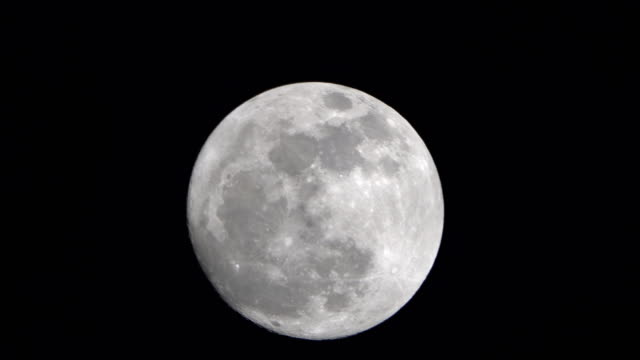 full moon in the night sky, zoom in - full moon stock videos & royalty-free footage