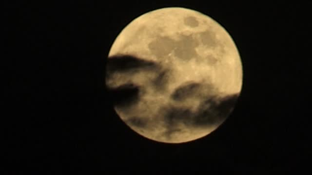 """full moon, known as """"strawberry moon"""" rises over the gulf emirate of dubai, marking the last """"supermoon"""" of 2021 - astronomy stock videos & royalty-free footage"""